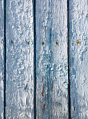 istock Old painted wooden fences with cracks 1211826452