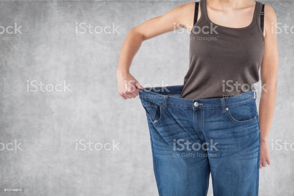 Old pants are too big stock photo