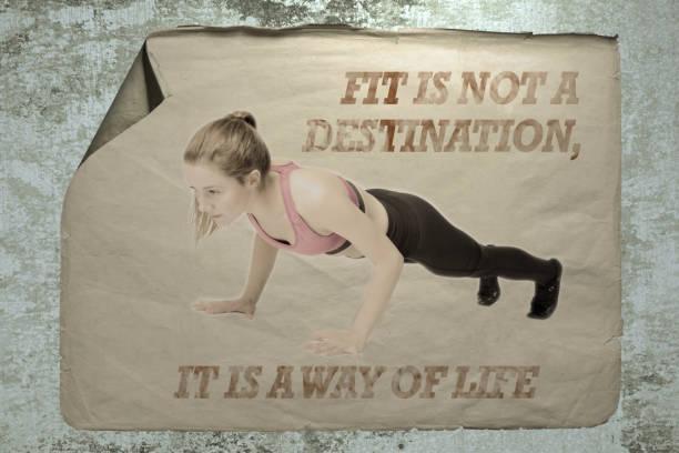 alte papier-anzeige auf einer betonmauer mit einem porträt einer jungen athleten frau und inschrift passen ist kein ziel, es ist ein weg des lebens. - motivationsfitness zitate stock-fotos und bilder