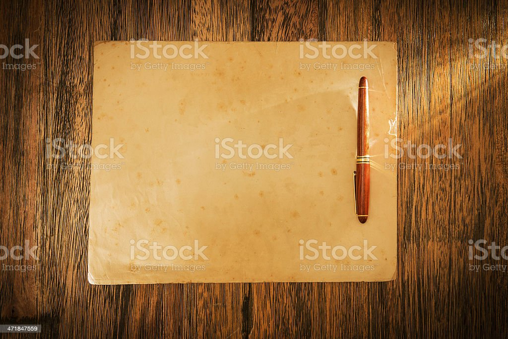 Old paper and pencil on desk royalty-free stock photo
