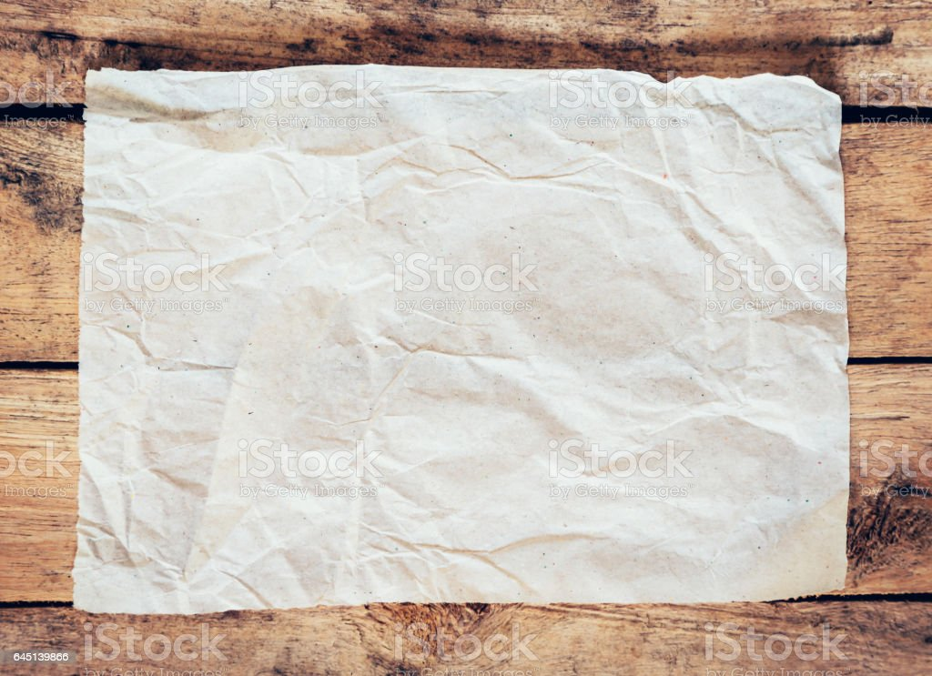 Old paper and poster vintage on wood background with space stock photo
