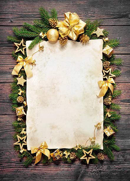 alten papier mit weihnachtsdekoration grenze - weihnachts wunschliste stock-fotos und bilder