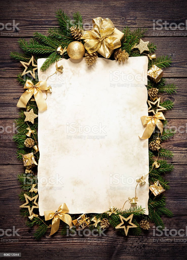 Old paper bordering with christmas decoration stock photo