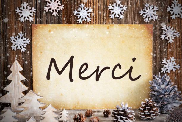 Altes Papier, Weihnachtsdekoration, Merci bedeutet Danke, Schneeflocken – Foto