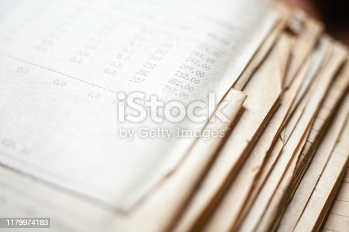 Old paper documents. Bookkeeping (accountancy). Calculations. Numbers printed on matrix printer.