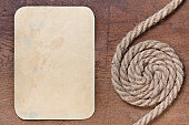 istock Old paper frame and rope on wood 153875917