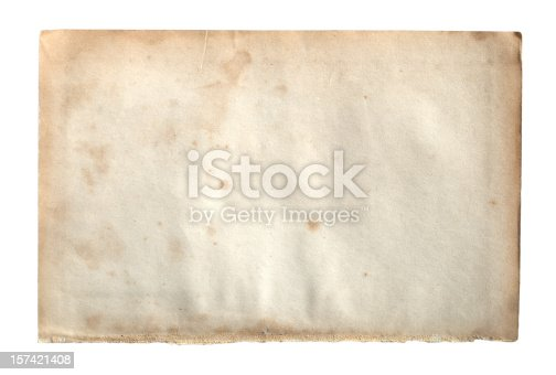 istock Old paper isolated on white background 157421408