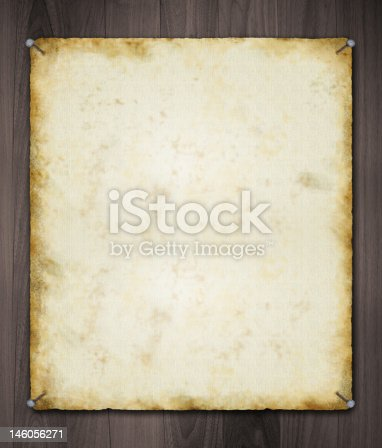 istock Old Paper Nailed on Black Ebony Wood Background 146056271