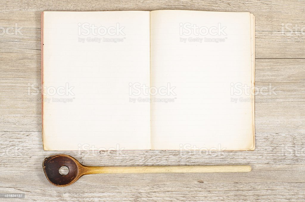 Old paper of a book with wooden spoon stock photo