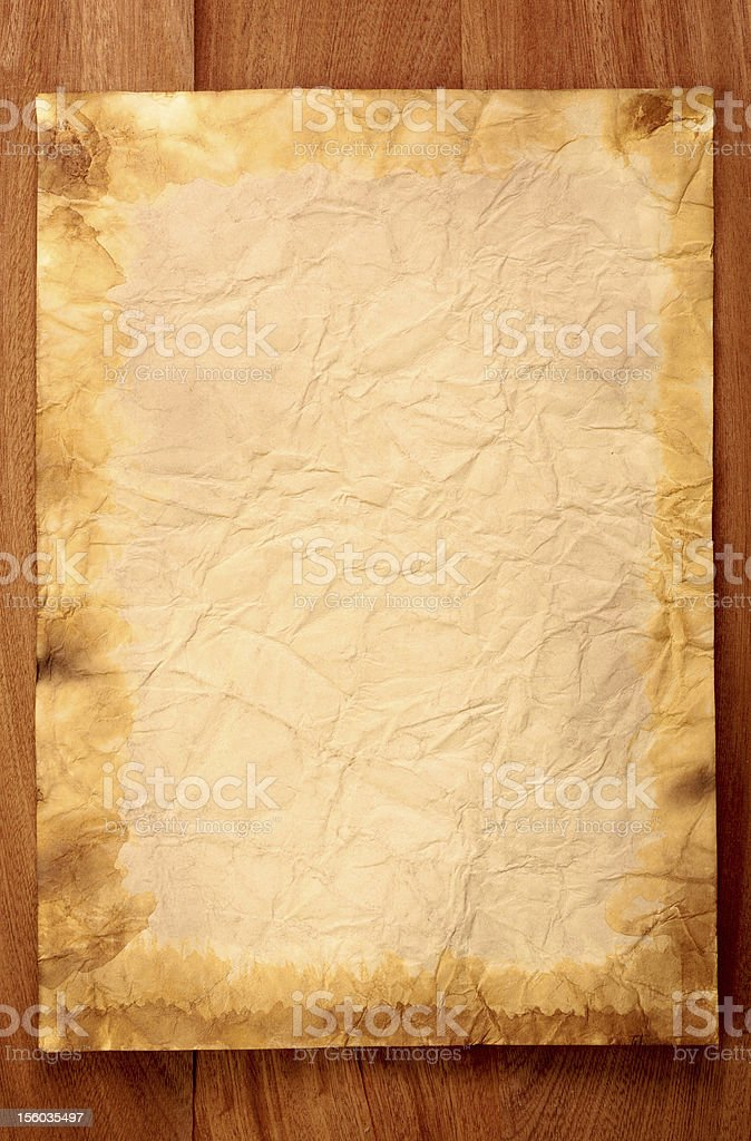 old paper on brown wood texture royalty-free stock photo