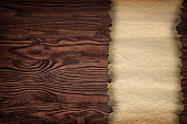 istock old paper on brown wood texture with natural patterns 817446056