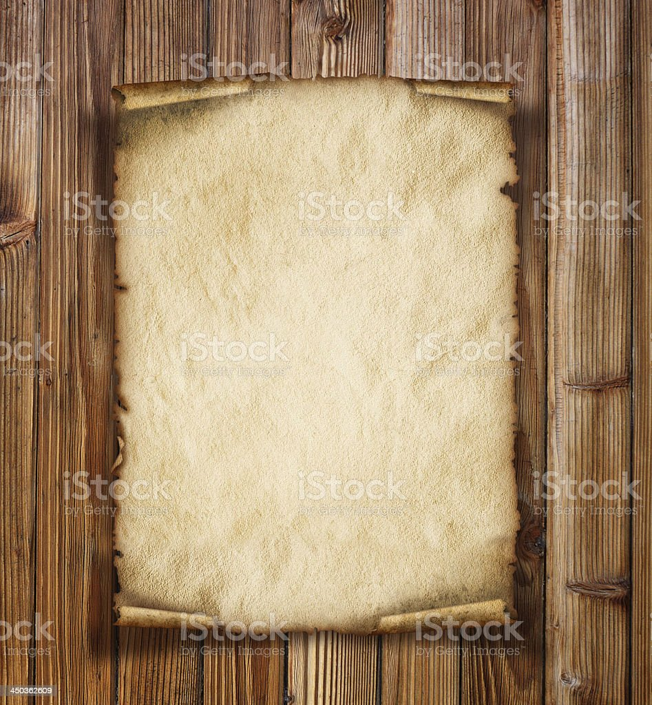 Old paper on the wood background stock photo