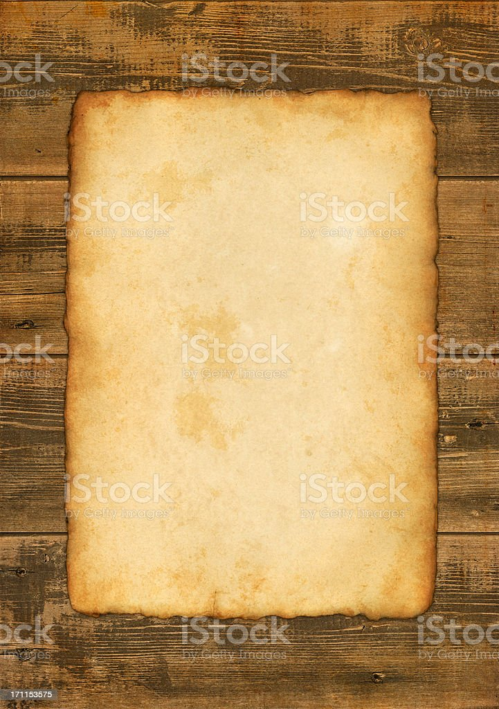 old paper on wooden background royalty-free stock photo