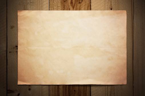 Old paper on wooden wall
