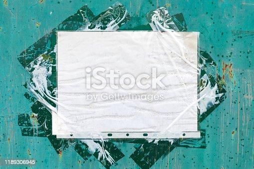 istock Old paper sheet in a punched pocket 1189306945