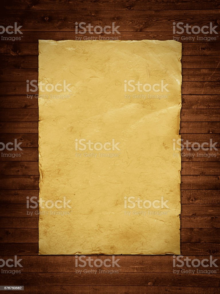 Old paper sheet on wooden backgroound stock photo