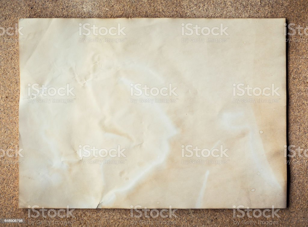 old paper texture on cork board background with space. stock photo