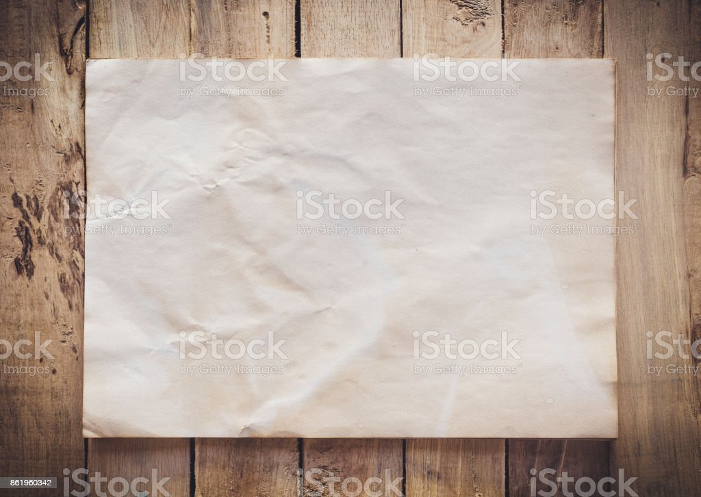 Old paper vintage on wood background with space stock photo