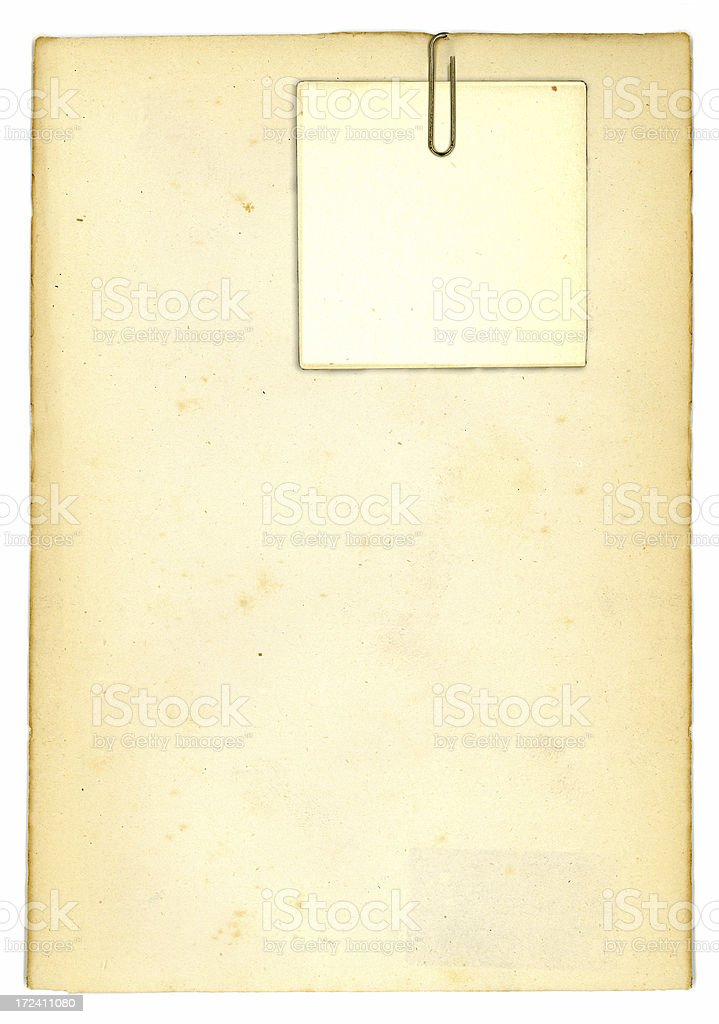 Old paper with clipped note card royalty-free stock photo