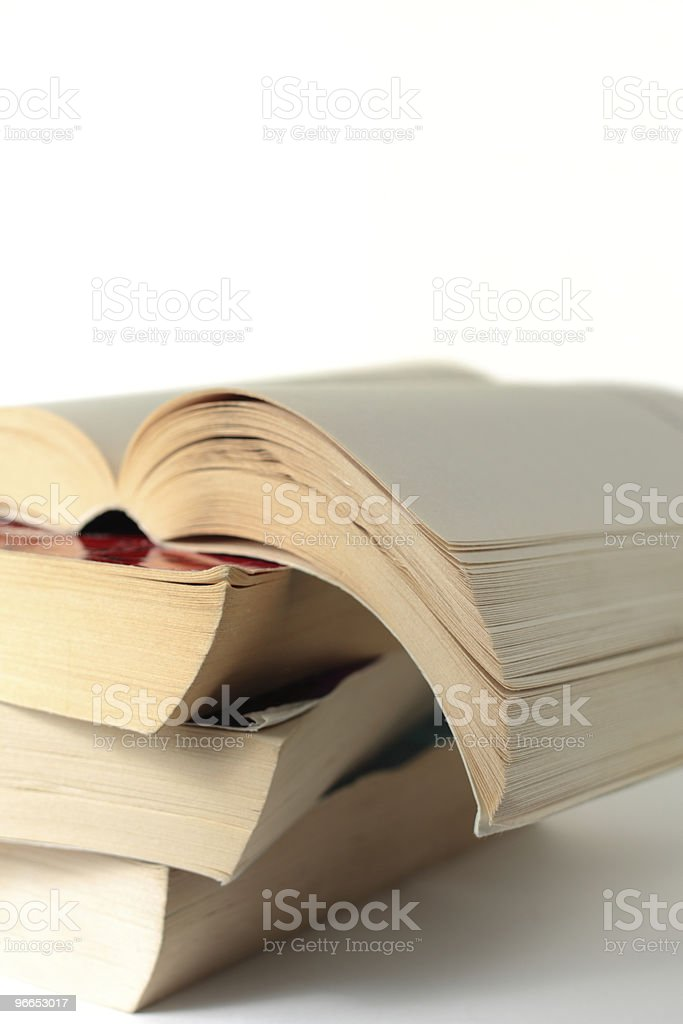 Old paperback books in a pile royalty-free stock photo