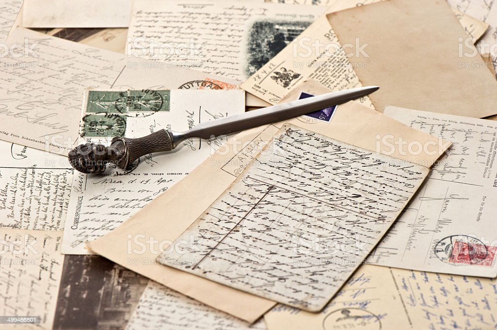 old papers and post cards with letter opener stock photo
