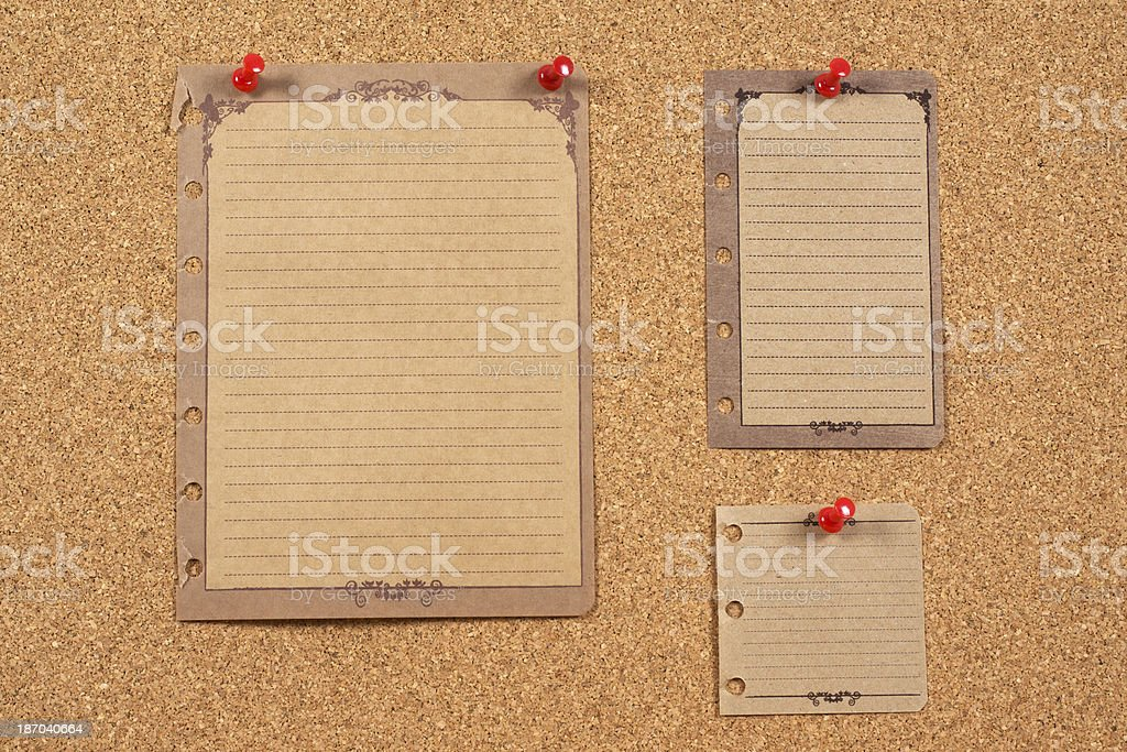 Old papers on corkboard royalty-free stock photo