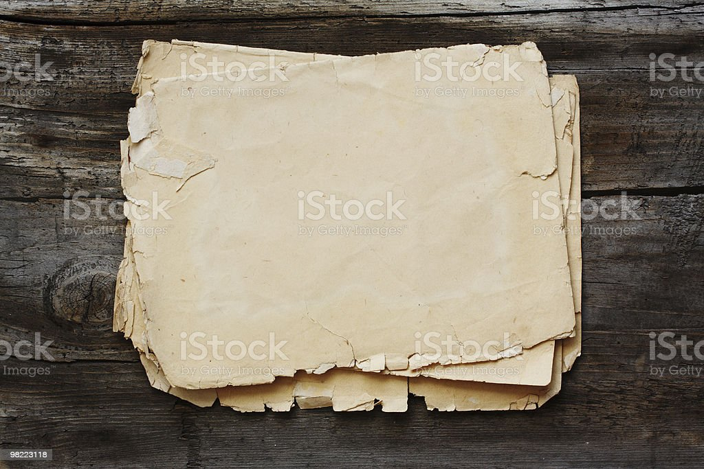 old papers on wooden background royalty-free stock photo