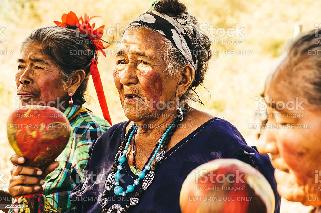 Old Paraguayan indigenous women performing a song stock photo