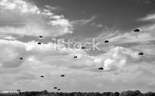 World War II era parachute drop in black and white