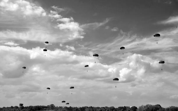old paratrooper drop - world war ii stock photos and pictures