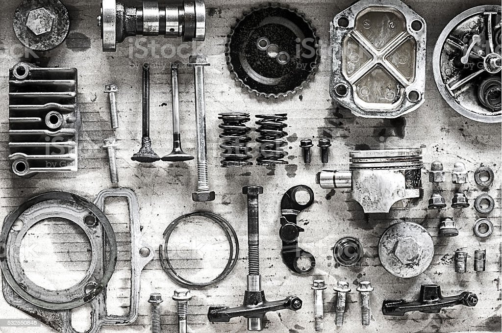 Old parts of motorcycles background with hard light black and white...