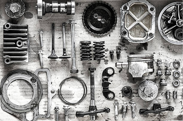 old parts of motorcycles background Old parts of motorcycles background with hard light black and white tone. repair and maintenance old parts of engine vehicle part stock pictures, royalty-free photos & images