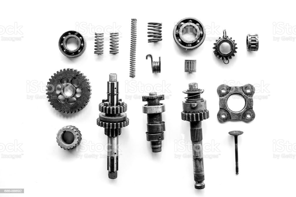 Old parts of motorcycles background with hard light black and white tone. repair and maintenance old parts of engine stock photo