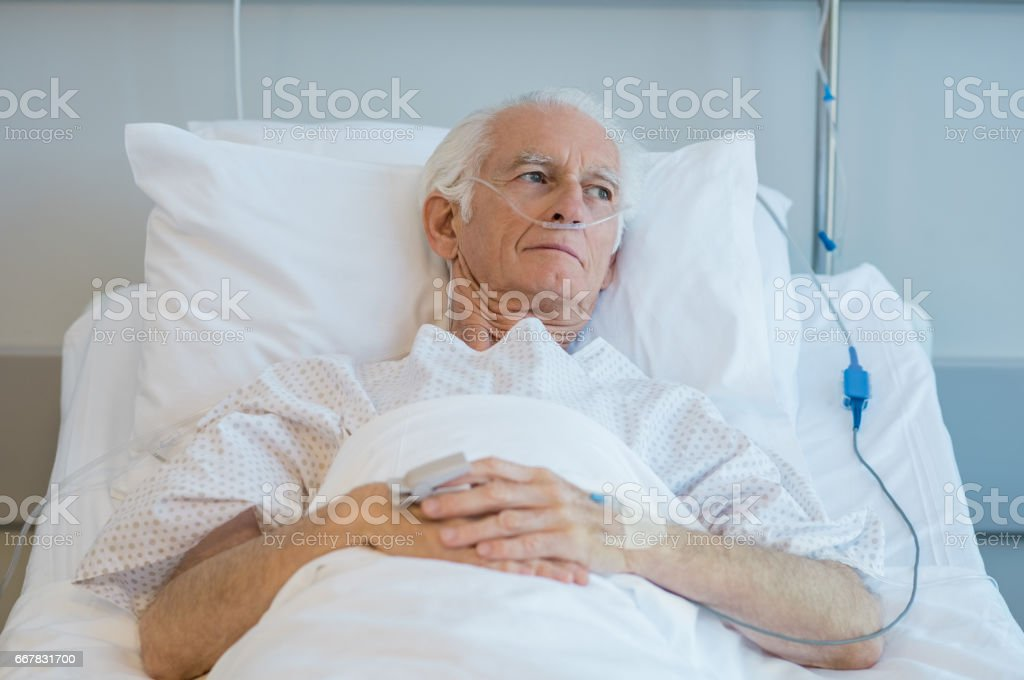 Old Patient Lying On Bed Stock Photo