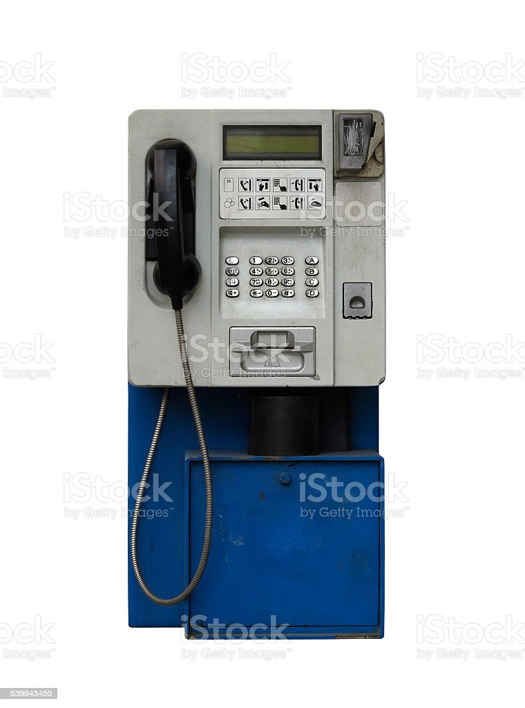 Old pay phone on white background stock photo