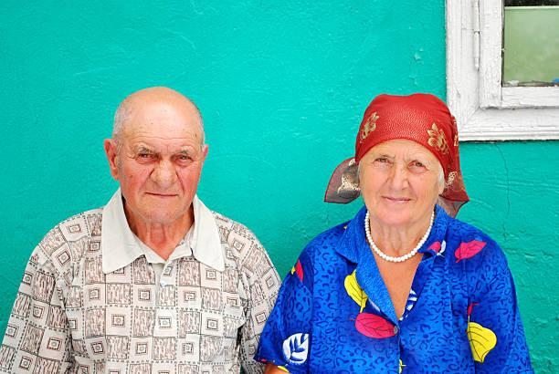 old peasant couple stock photo