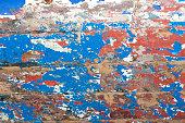 old peeling paint on wooden boat
