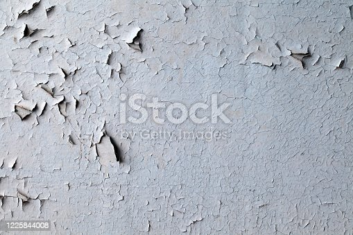 Old peeling paint on uneven surface