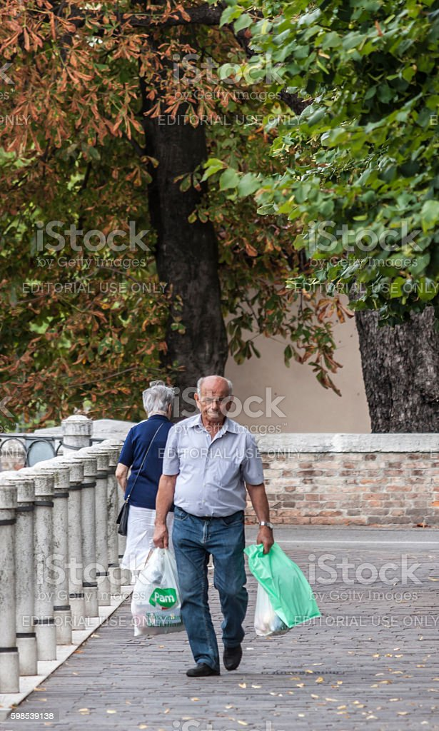 Old people coming from supermarket stock photo