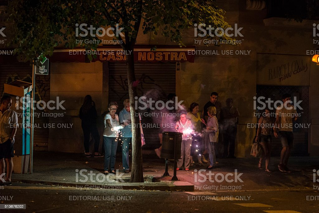 Old people throwing firecrackers, Barcelona stock photo