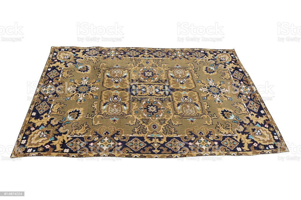 Old Persian carpet isolated on a white background. stock photo