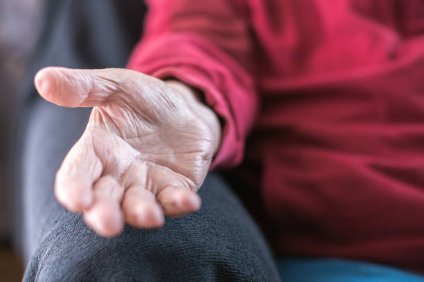 old person reaching for help stock photo