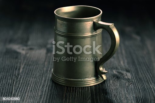 istock Old Pewter Mug on a wooden table 804040580