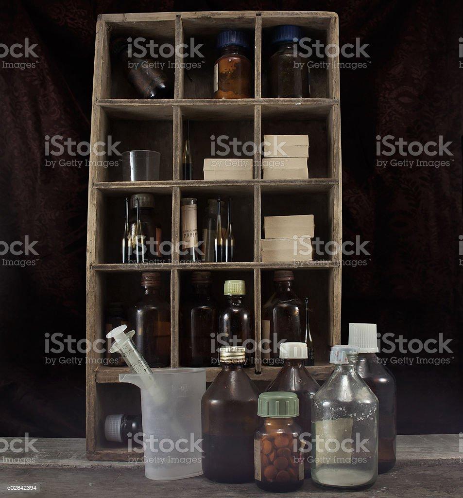 Old pharmacy alchemist table. stock photo