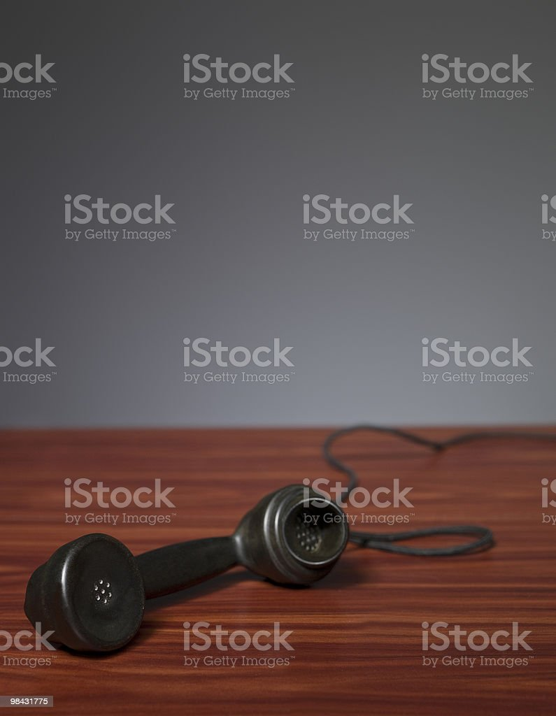 Old phone receiver on a desk royalty-free stock photo