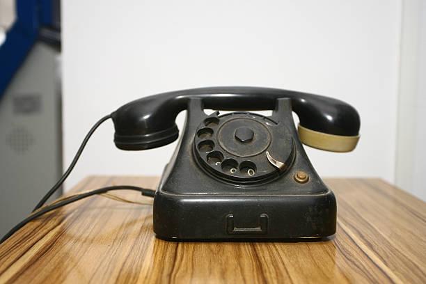 Antigo telefone antigo telefone de mesa - foto de acervo