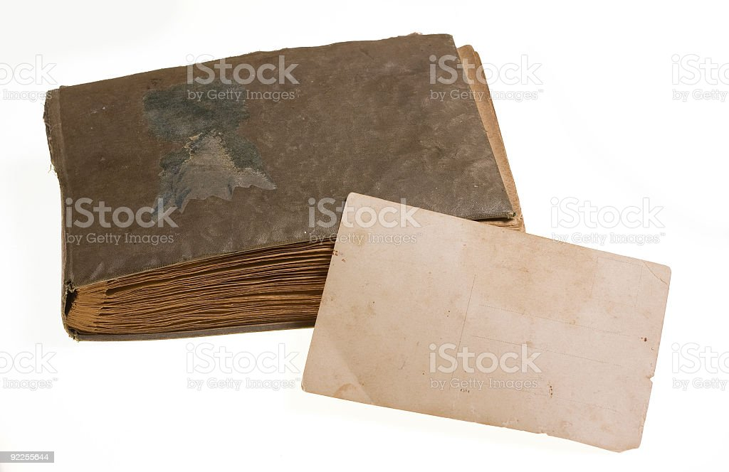 Old photo album with postcard royalty-free stock photo