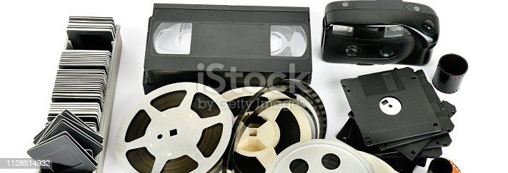 1125303139 istock photo Old photo and video equipment isolated on white background. 1128514932