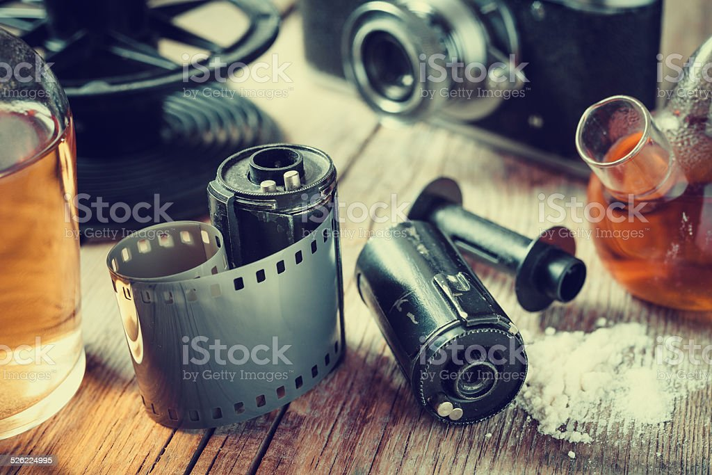 Old photo film rolls, cassette,  camera and chemical reagents stock photo