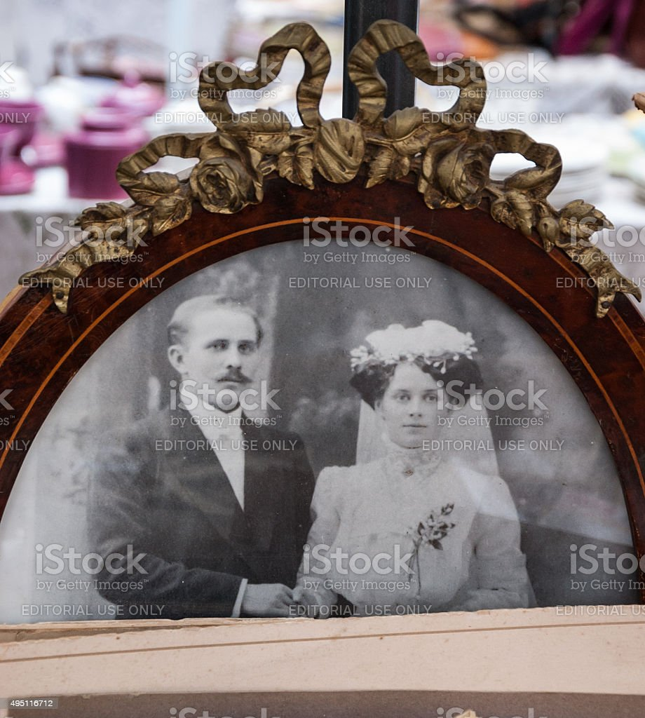 Old Photo Of Bride And Groom At Flea Market Stock Photo